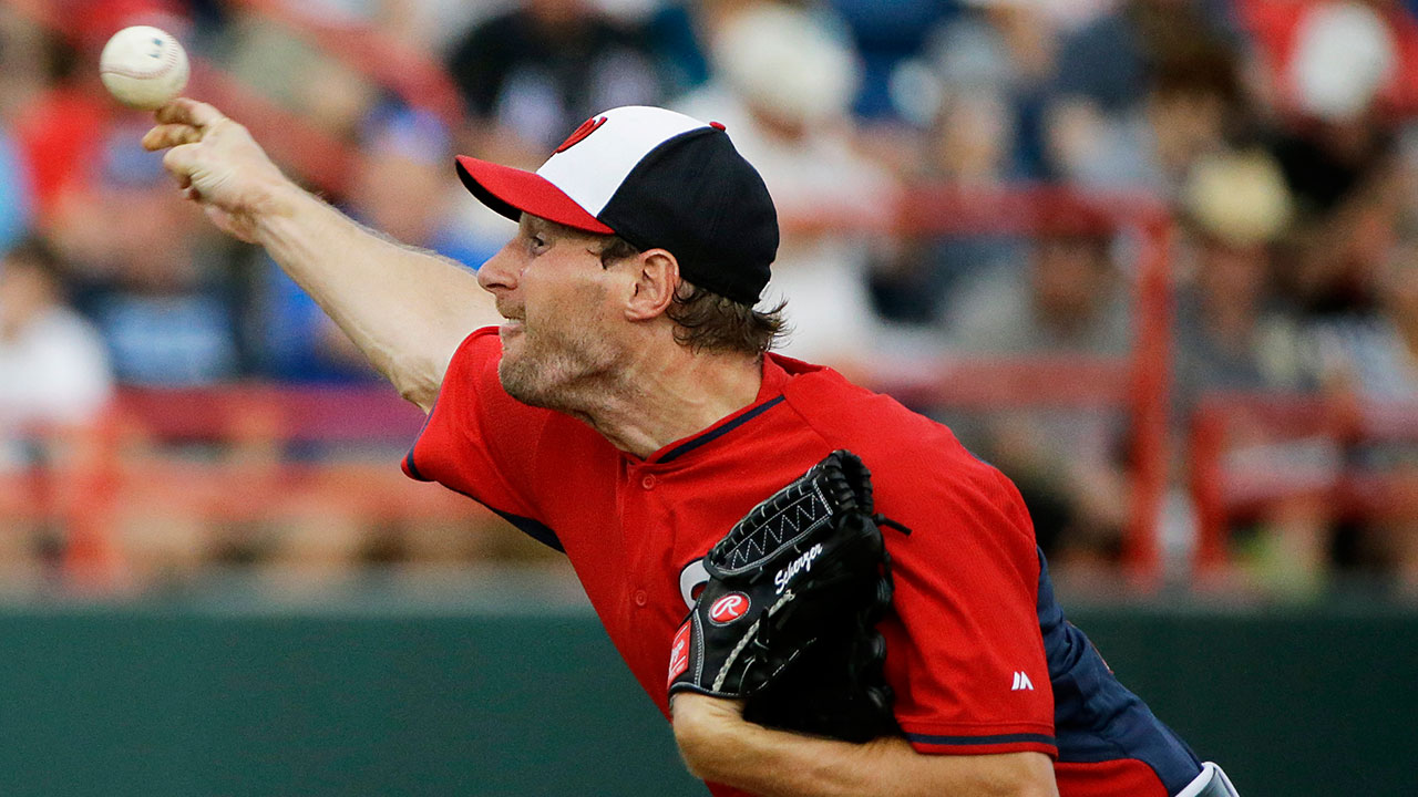 Scherzer strikes out two in debut with Nationals